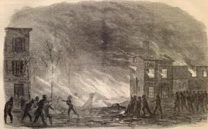 """Hadsall refers to the fire in Philadelphia that occurred on 8 February 1865. The fire originated about 2:30 A.M., in Washington Street, near Ninth, where there was an open lot on which Blackburn & Co. had between two and three thousand barrels of petroleum stored on account of various owners. The Philadelphia Bulletin: """"The blazing oil that escaped from the burning barrels poured over into Ninth Street and down to Federal, filling the entire street with a lake of fire, and igniting the houses upon both sides of Ninth Street for two squares, and carrying devastation into Washington, Ellsworth, and Federal streets, both above and below Ninth Street."""""""