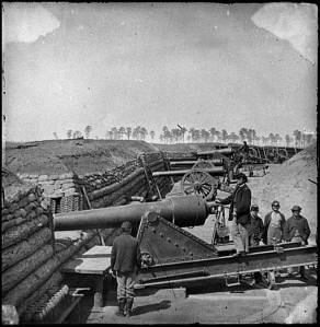The 100-pounder Parrott Gun dislodged from its carriage at Fort Brady appears in the foreground.